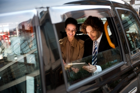 taxis: Business people traveling around the city Stock Photo
