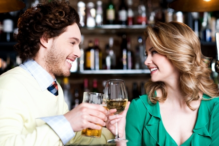 Lovely couple enjoying their drinks together photo
