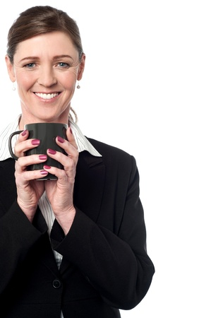 Beautiful smiling professional woman holding a coffee mug photo