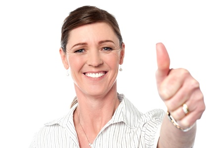 posing  agree: Attractive business lady showing thumbs up to camera