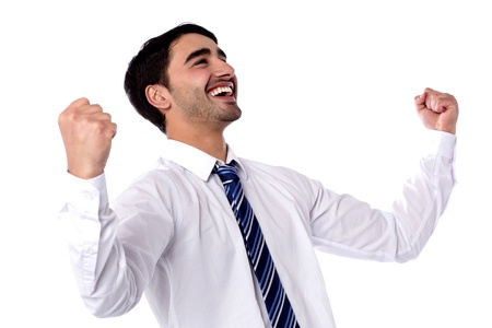 clenching fists: Successful businessman clenching fists in excitement