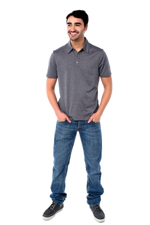 good looking model: Young guy standing with hands in jeans pocket