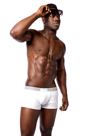 African masculine male model holding his goggles photo