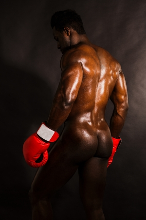 naked man: Muscular african boxer posing, naked shot in studio  Stock Photo