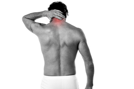Young man having pain in his neck Stock Photo - 21394758