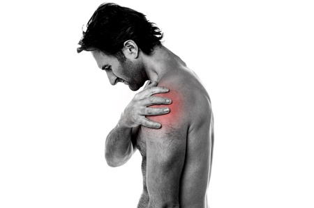 Man having shoulder joint pain in his left shoulder  Stock Photo - 21429475