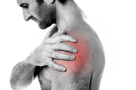 shoulder problem: Young man having shoulder joint pain, closeup shot
