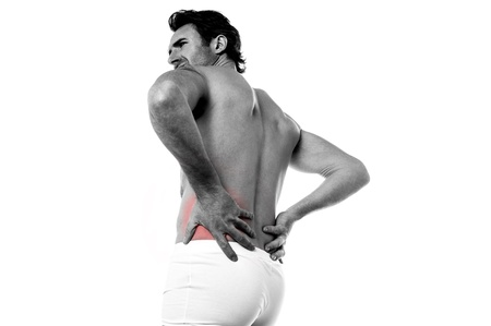 reddening: Isolated young man suffering from lower back pain