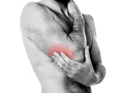 reddening: Man holding his elbow in pain