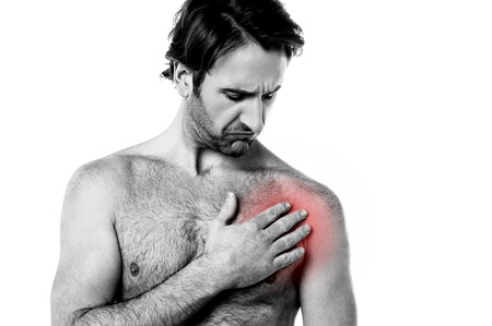 Young man suffering pain on his chest  photo