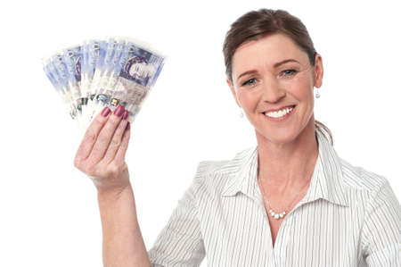 Woman showing british pound currency notes photo