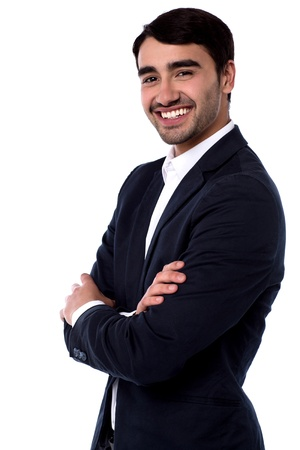 Confident young business executve with arms crossed photo