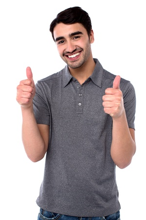 yup: Guy in casuals gesturing double thumbs up