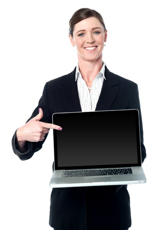 Female executive promoting a brand new laptop photo