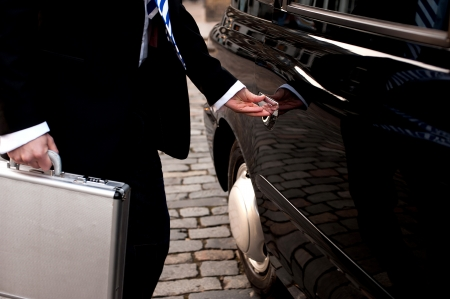 cropped image: Cropped image of a male passenger opening taxi cab door Stock Photo