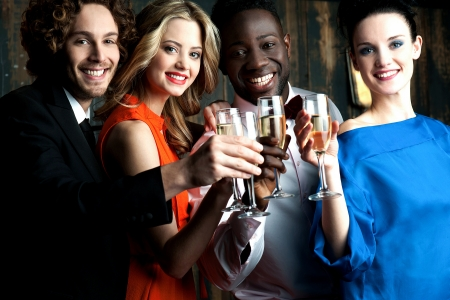 friends at bar: Friends enjoying champagne or wine in a party Stock Photo