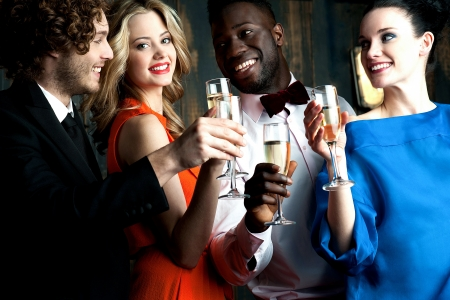 cheers: Carefree young couples having cocktails and partying Stock Photo