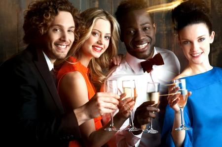 Group of friends enjoying drinks in restaurant bar photo