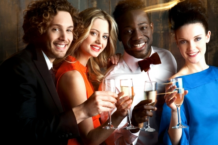 Group of friends enjoying drinks in restaurant bar Stock Photo