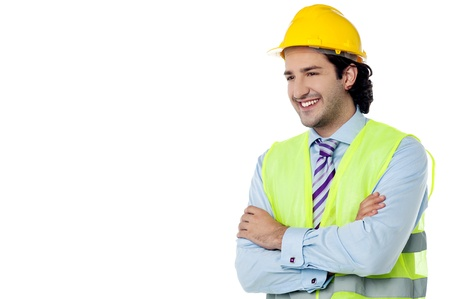 Construction engineer posing with arms crossed photo
