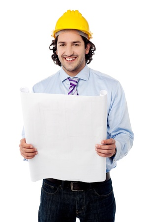review site: Smiling construction worker reviewing blueprint Stock Photo