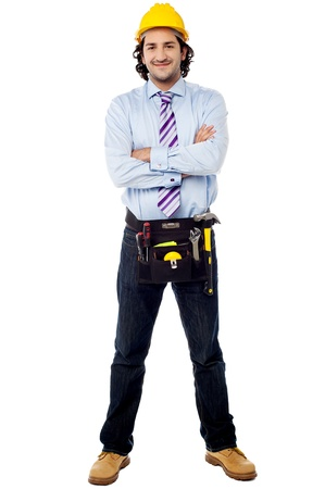 Architect with tool belt around his waist photo