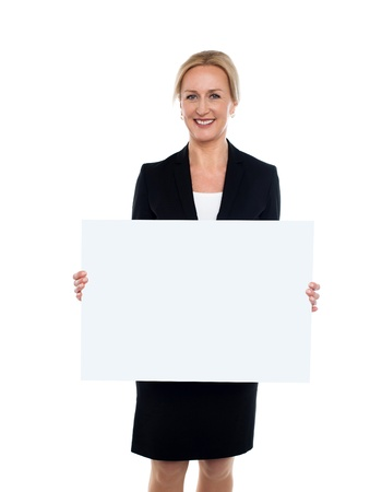 Happy corporate woman displaying blank whiteboard photo