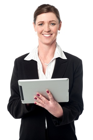 Smiling female manager operating tablet device photo