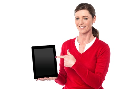 Pretty woman displaying newly launched tablet device photo