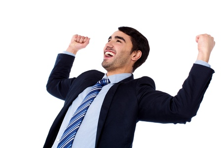 Excited young businessman clenching fists Stock Photo
