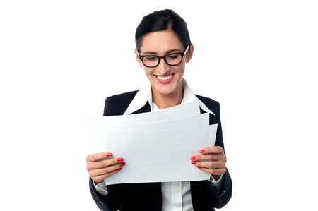 Happy corporate lady looking at the reports photo