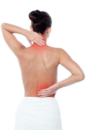 collo: Giovane donna che ha al collo e mal di schiena Archivio Fotografico