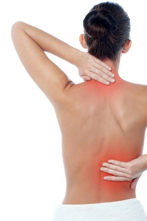 lower back pain: Young woman having neck and backache Stock Photo