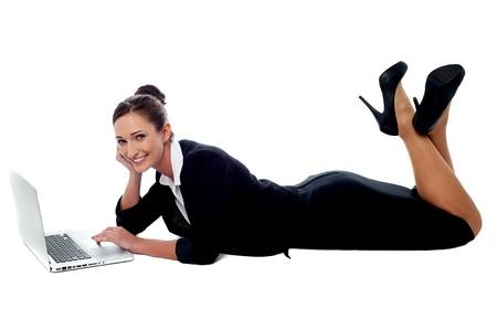 Calm business lady lying on the studio floor Stock Photo