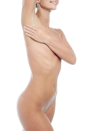 nude woman standing: Naked young woman over white background