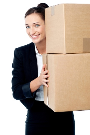 Smiling business executive carrying cartons photo