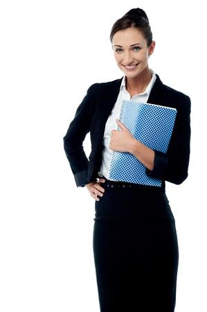 Pretty female executive holding notebook Stock Photo - 21961372
