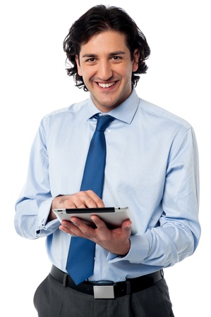 Business professional browsing on tablet pc photo