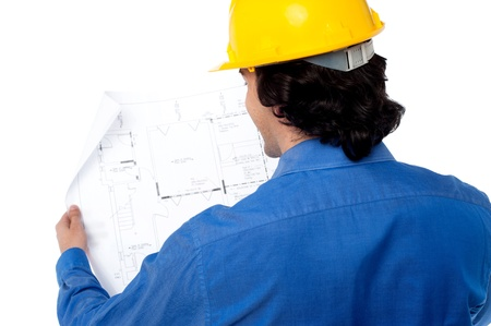 Construction engineer analyzing the building plan photo