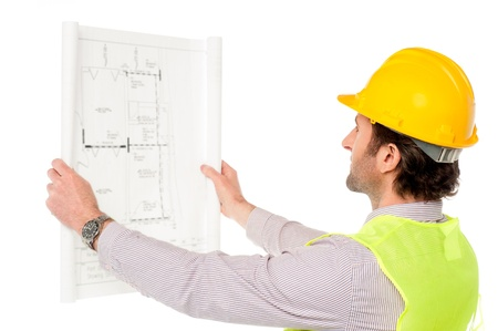 Young construction engineer analyzing building plan photo