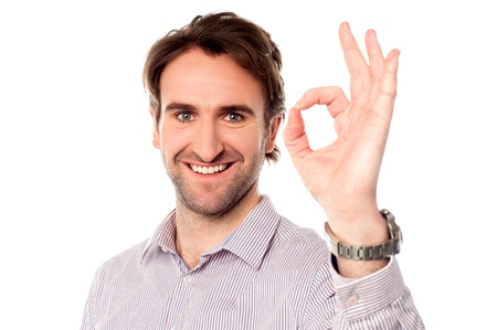Handsome young man showing perfect gesture