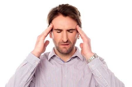 wincing: Man suffering from headache wincing