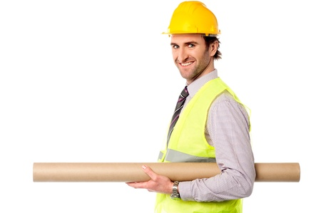 Young construction engineer holding building map photo