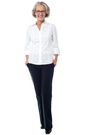 woman standing: Attractive senior lady in business attire Stock Photo