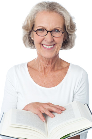 Image of aged woman with an open book