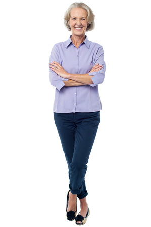 Smiling confident aged woman posing casually Stock Photo
