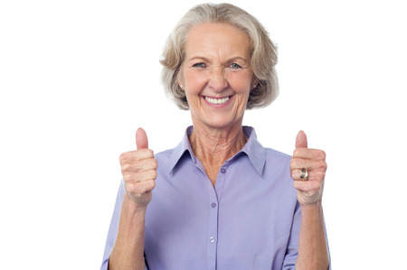 yup: Smiling old lady showing double thumbs up Stock Photo