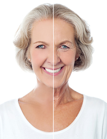Smiling aged woman isolated over white Stock Photo