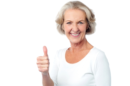 yup: Image of a senior lady showing success gesture Stock Photo