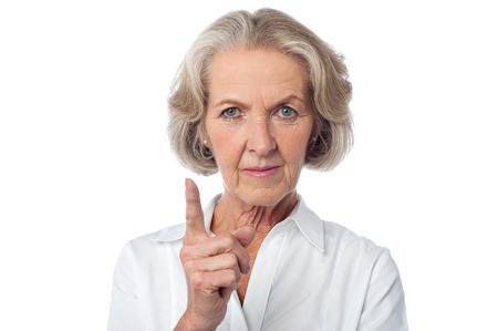 Angry aged woman warning you. photo